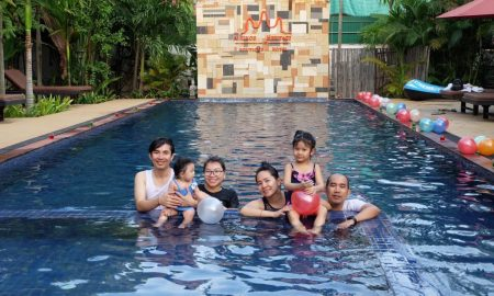 Family-at-pool-1024x683